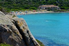 La Maddalena seascape. With blue sea and beach with people surrounded by nature Royalty Free Stock Photos