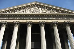La Madeleine Church Paris. The Mary Magdalene Church in downtown Paris, France. Detail of the facade of the church with Greek Corinthian Columns and a sculpture royalty free stock image