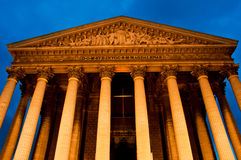 La madeleine church in Paris by night stock images