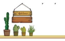 La madera y el cactus de la caída adornan imagenes de archivo