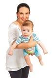 La madre que celebra al bebé con de largo babea Imagenes de archivo