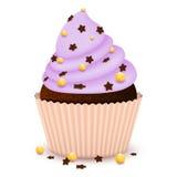 La magdalena del chocolate con adorna Imagenes de archivo