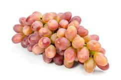 La maggior parte del mazzo maturo e succoso di uva isolata sul primo piano bianco Fotografia Stock Libera da Diritti