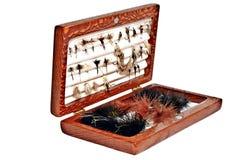 La main a attaché des mouches de pêche Photographie stock libre de droits
