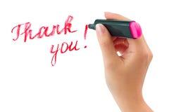 La main avec l'écriture de repère vous remercient image stock