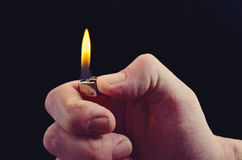 La main avec l'allumeur Images libres de droits