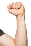 La main avec a serré un poing Photographie stock libre de droits