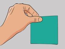 La main colle la note Image libre de droits