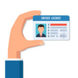 La main détient un permis de conduire Image libre de droits