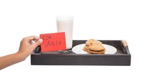 La main d'enfants offre le lait, biscuits pour Santa V Photo libre de droits