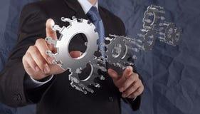 La main d'homme d'affaires montre la vitesse au concept de succès Photos stock