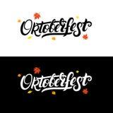 La main d'Oktoberfest écrite marquant avec des lettres le fond avec la chute part Image stock