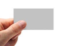 la main de carte de visite professionnelle de visite a isolé Image stock
