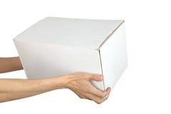 La main de l'homme avec le cadre photo stock