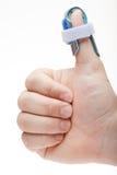 La main de l'homme avec le spint de pouce Photos libres de droits