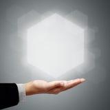 La main de l'homme d'affaires ont l'hexagone ci-dessus Photo stock