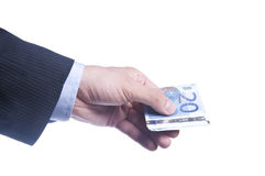 La main de l'homme retient un paquet d'euro Photos libres de droits