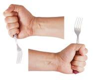 La main de l'homme retient une fourchette Photographie stock libre de droits
