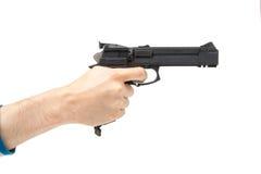 La main de l'homme tenant l'arme à feu, d'isolement sur le blanc Photo stock