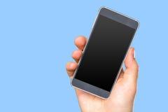 La main de l'homme tenant le smartphone Photo stock