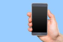 La main de l'homme tenant le smartphone Images stock