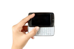 La main de la femme retenant l'écran tactile de téléphone portable Photo libre de droits