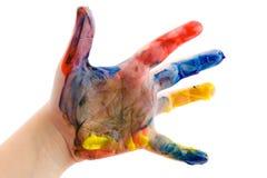 La main des enfants dans la peinture Photographie stock libre de droits