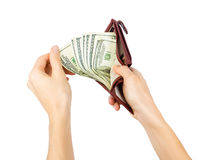 La main des hommes obtient des dollars d'une bourse Images stock