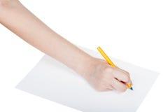La main dessine par le stylo bleu sur la feuille de papier Photographie stock