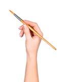 La main dessine une brosse photos libres de droits
