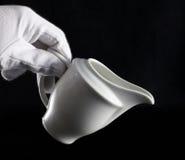 La main du bac de lait Images libres de droits