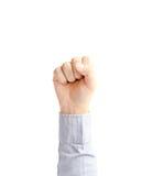 La main du jeune homme d'affaires avec a serré un poing d'isolement sur le blanc Photographie stock libre de droits