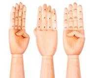 La main en bois montre quatre doigts images libres de droits