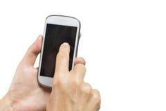 La main femelle écrit des sms à un téléphone intelligent Image stock