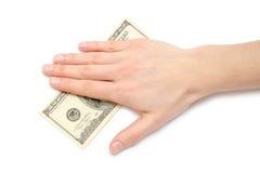 La main femelle prend ou donne cent dollars US Photo libre de droits