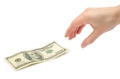 La main femelle prend ou donne cent dollars US Images libres de droits