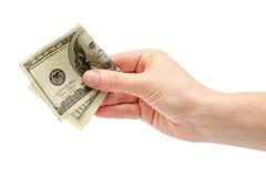 La main femelle prend ou donne cent dollars US Image stock
