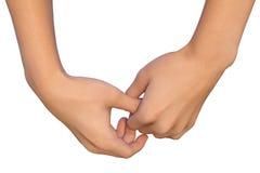 La main femelle tient le pouce d'une autre paume femelle Photos libres de droits