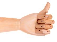 La main fictive en bois aiment le signe image stock