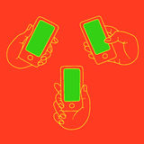 La main garde les icônes mobiles et réglées Photos libres de droits