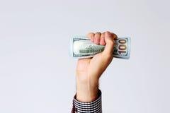 La main masculine a augmenté avec la facture des dollars Images libres de droits