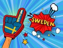 La main masculine dans le gant de drapeau de pays d'une fan de sports a soulevé célébrer la bulle de victoire et de parole de la  Photo libre de droits