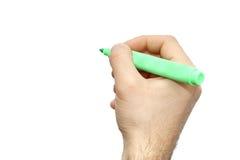 La main masculine de fond blanc avec le marqueur d'isolement écrivent quelque chose Images libres de droits
