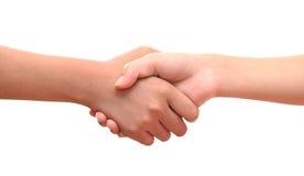 La main masculine et femelle a uni la poignée de main sur le backgrou blanc d'isolement Photo stock