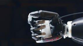 La main prosthétique déplace des doigts, équipement cybernétique banque de vidéos