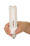 La main retient de pouvoir de sauvegarder la lampe vers le haut Image libre de droits