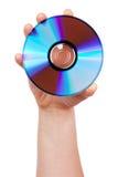 La main retient le CD Images stock