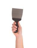 La main tient la spatule de construction Photographie stock
