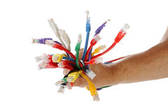 La main tient le groupe de câbles Photographie stock