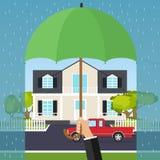 La main tient un parapluie au-dessus de la maison Le concept de la sécurité à la maison Photos libres de droits